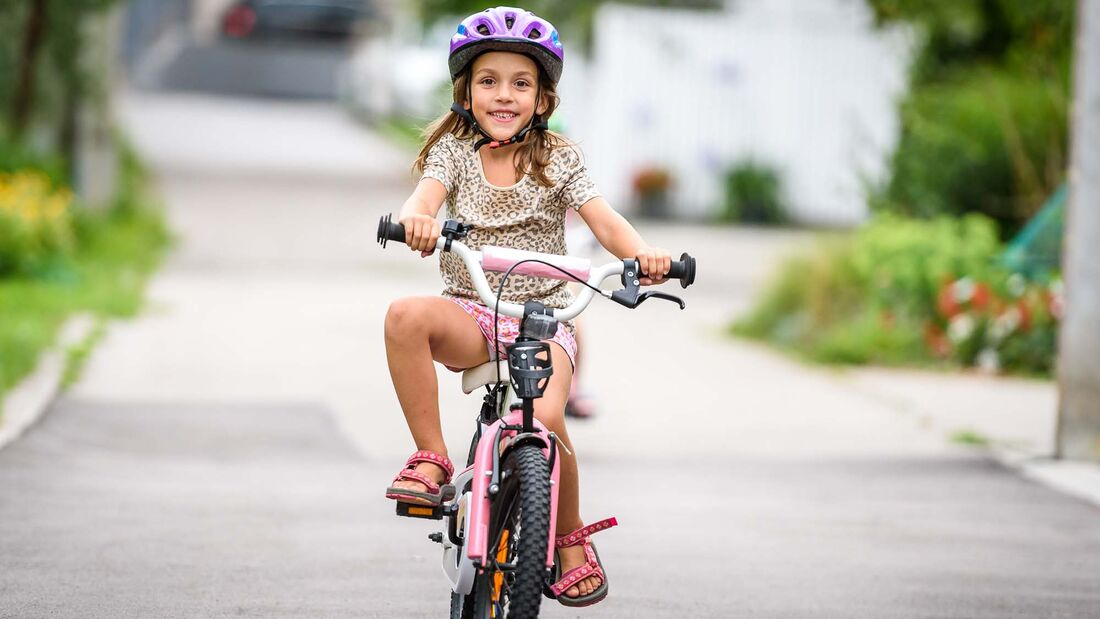 Girl Riding Bicycle On Road