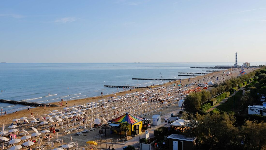 Jesolo tourist beach at sunset