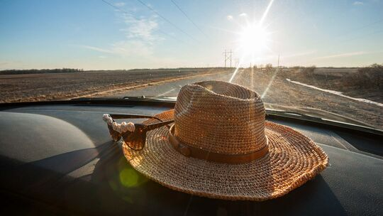 Straw hat in the car