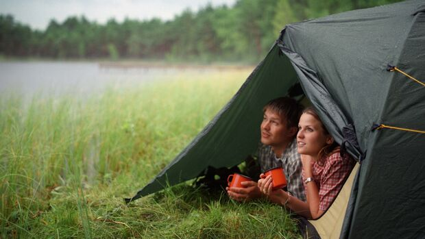 Young Couple in Tent by Lake